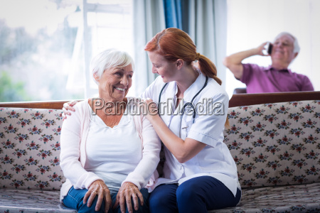 senior woman and female doctor interacting