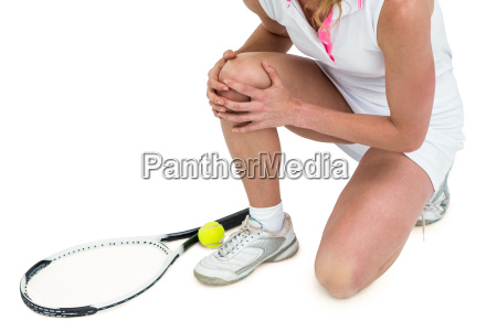 injured athlete with tennis racket and