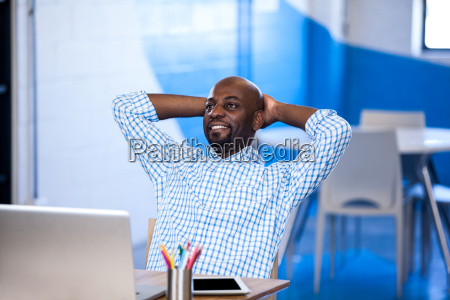 relaxed businessman front of his laptop