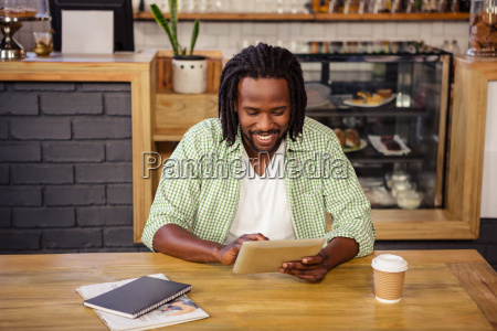 young man using digital tablet in
