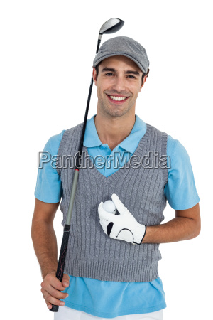 portrait of golf player standing with