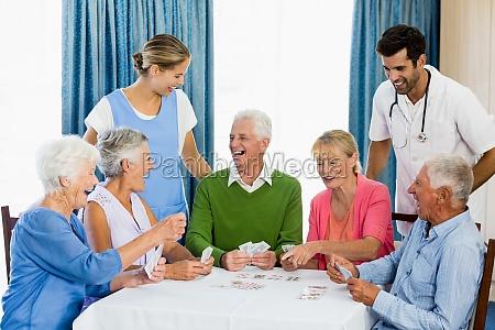seniors playing cards