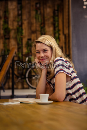 woman sitting at a table sitting