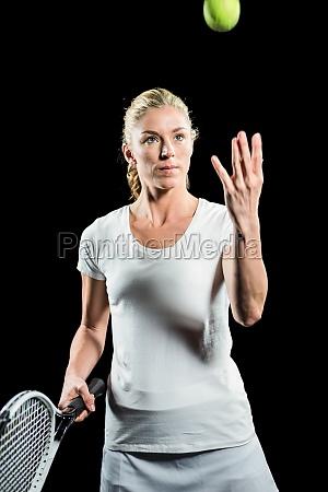 tennis player holding a racquet ready