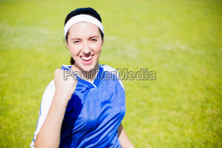 happy soccer player posing after victory