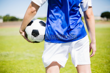 mid section of soccer player standing