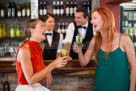 happy friends holding a glass of