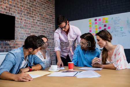 front view of meeting of coworkers