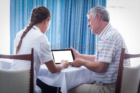 senior man and female doctor using