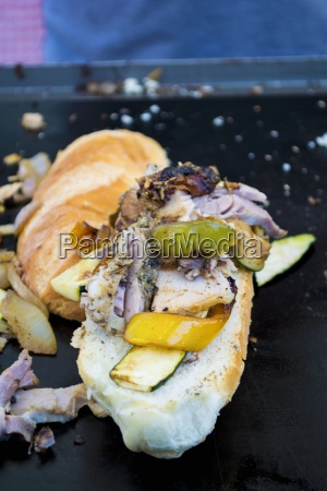 a street food sandwich with yellow