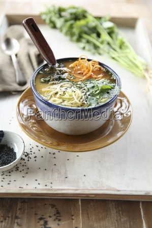 asian miso soup with raw vegetables