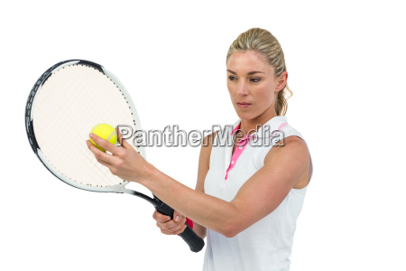 athlete holding a tennis racquet ready