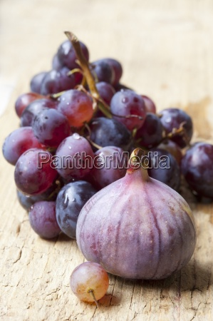 fresh red grapes and figs on