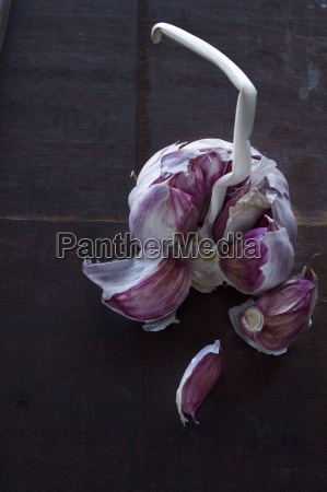 garlic with cloves removed against a