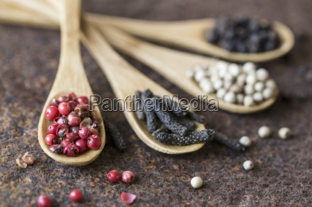 four different types of pepper on