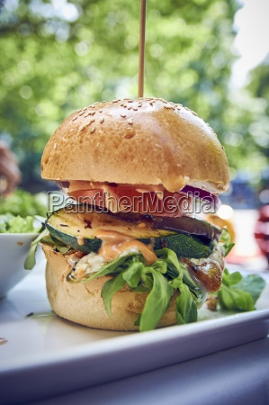 a veggie burger with courgette and