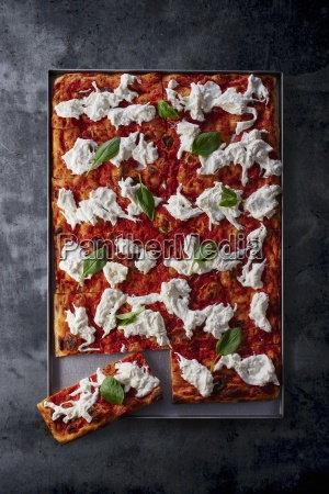 a pizza with tomatoes burrata and