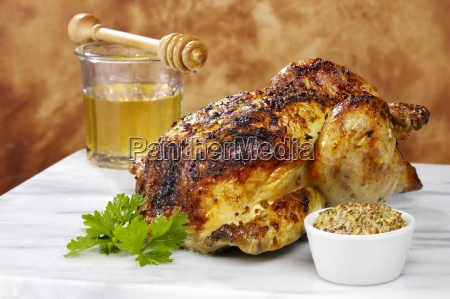 a whole cooked roast chicken with