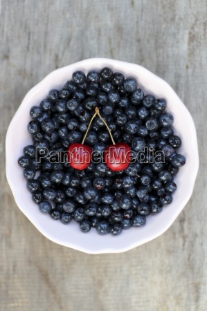 blueberries and a pair of cherries
