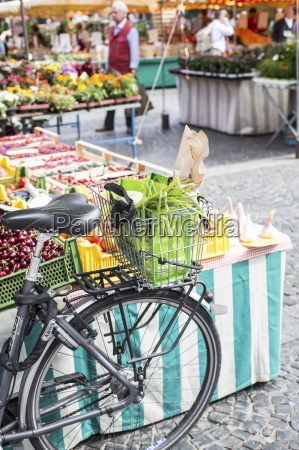 a bike with somebodys shopping in
