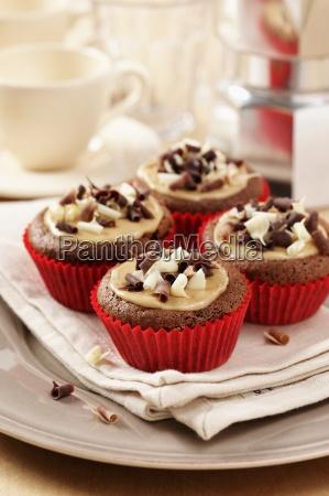 mocha chestnut cupcakes on a cream