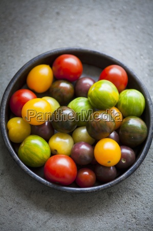 assorted tomatoes in a dish