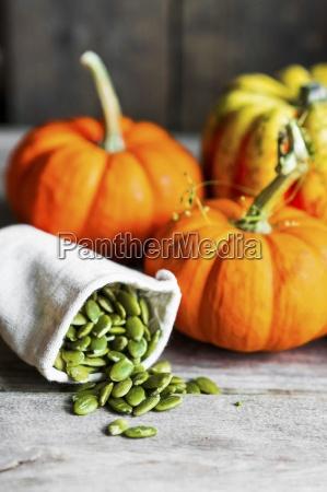an arrangement of pumpkins and pumpkin