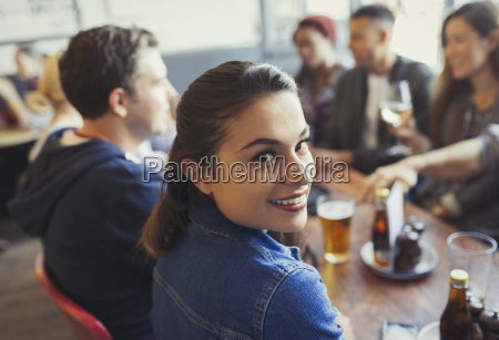 portrait smiling woman drinking beer with