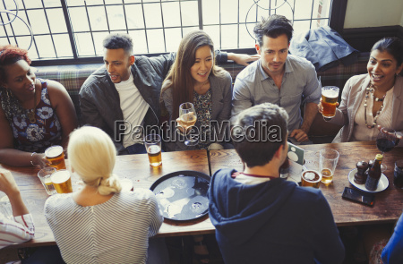 overhead view of friends drinking beer