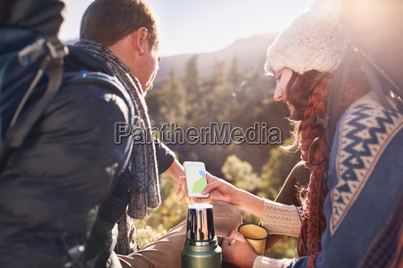 young couple hiking taking a coffee