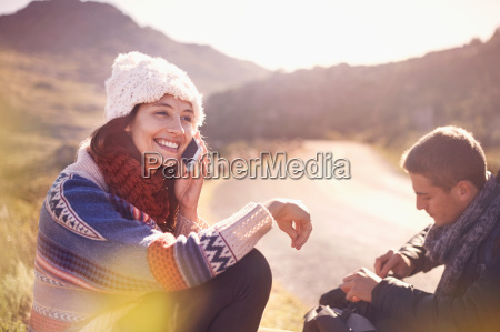 smiling young woman talking on cell