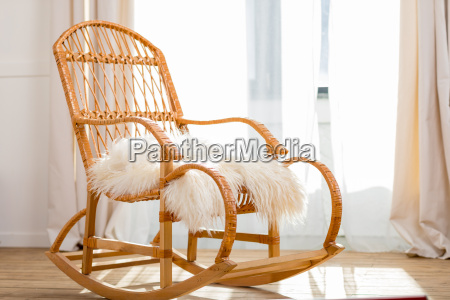 rocking chair with woolly rug in