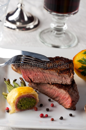 steak with bacon beans on a