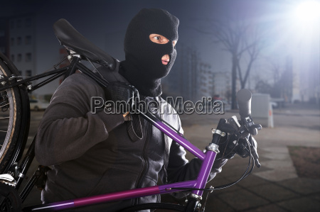 thief stealing a cycle