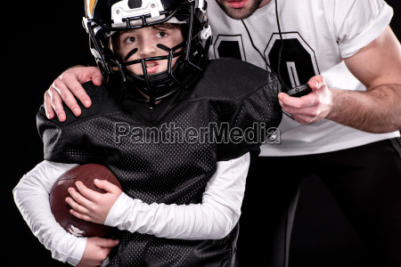 cropped shot of boy and trainer