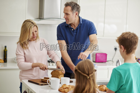a family of four people parents