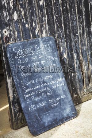 a menu board advertising seasonal suppers