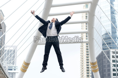 success concept asian businessman jumping with