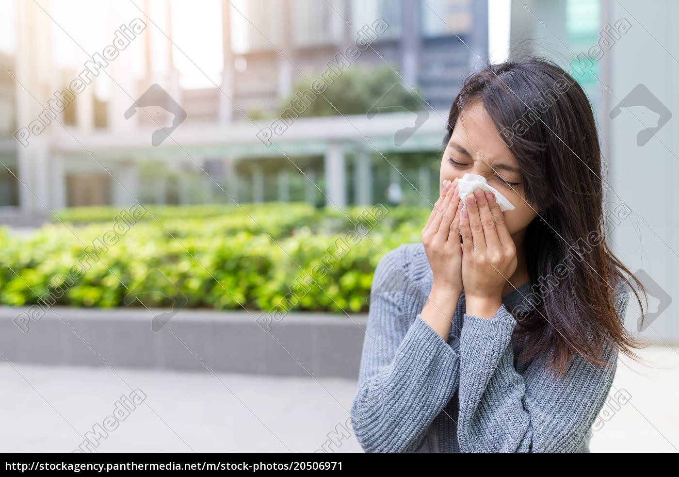 asian, woman, sneezing, at, outdoor - 20506971