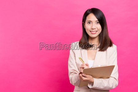 business, woman, taking, note, on, clipboard - 20506603