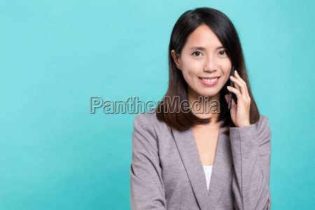business, woman, talk, to, cellphone - 20506711
