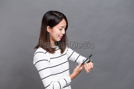woman, connect, smart, watch, and, cellphone - 20506701