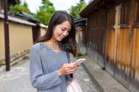 woman, looking, at, cellphone, at, kanazawa - 20506807