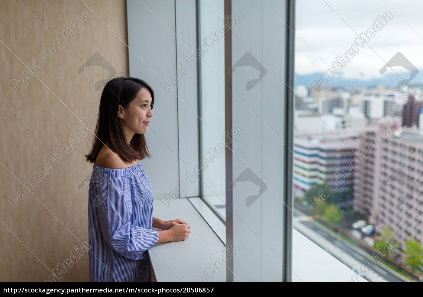 woman, looking, outside, at, lookout, tower - 20506857