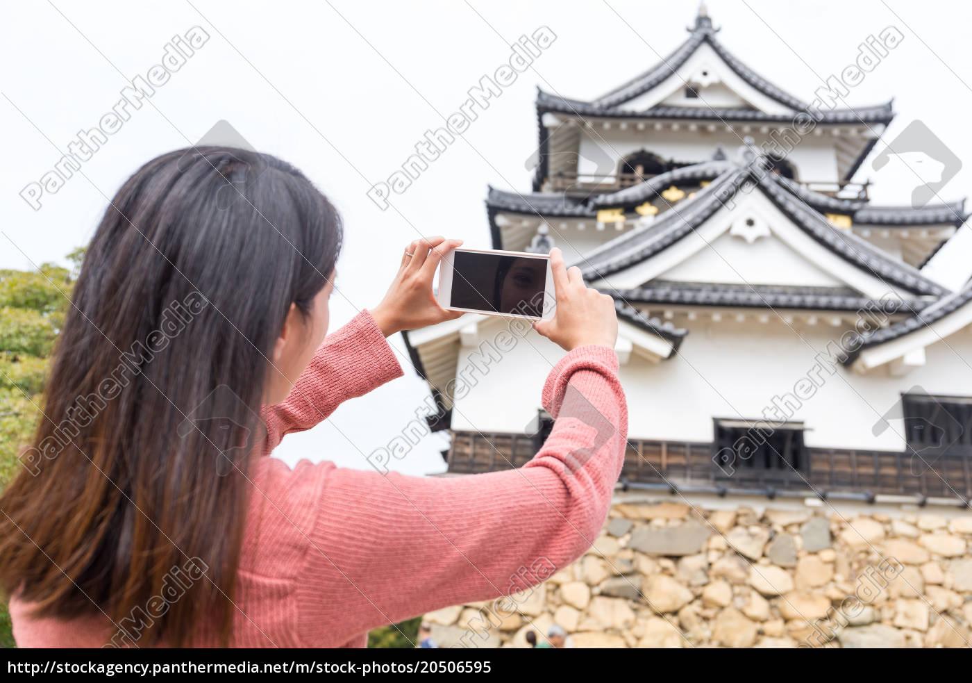 woman, taking, photo, on, hikone, castle - 20506595