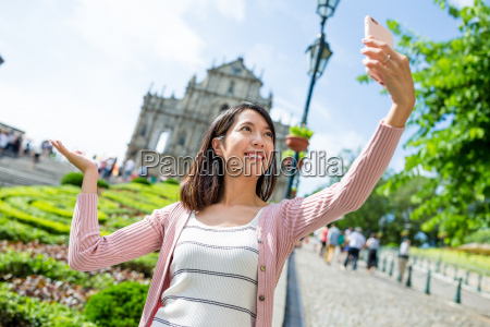 woman, taking, self, image, with, saint - 20506565