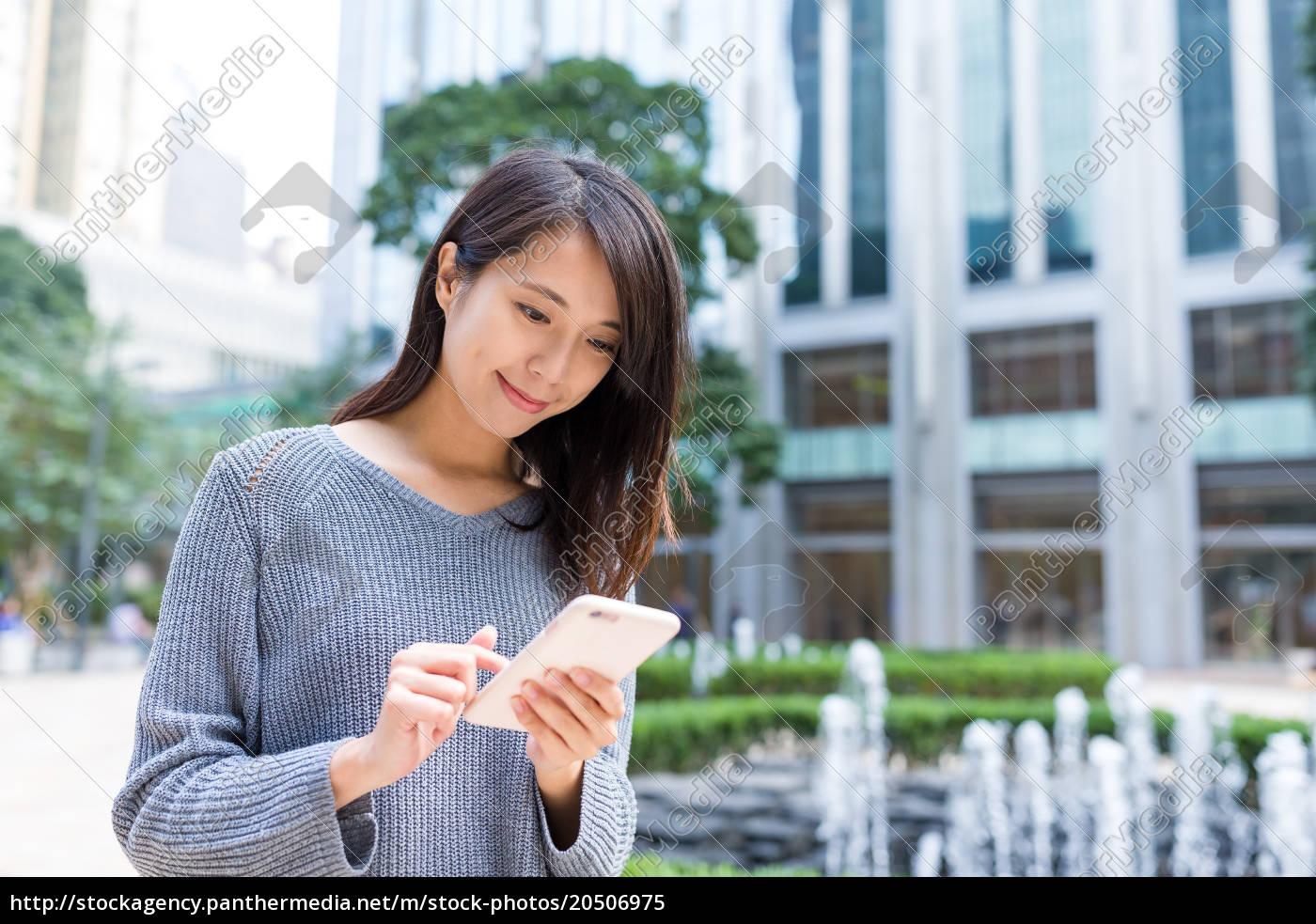 woman, using, mobile, phone, at, hong - 20506975