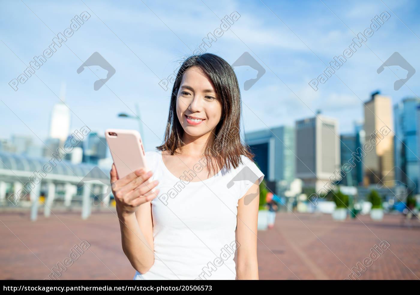 woman, using, smart, phone, in, hong - 20506573