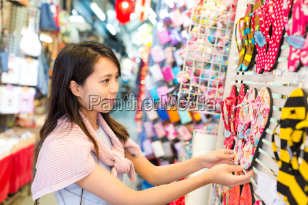woman shopping at street market in