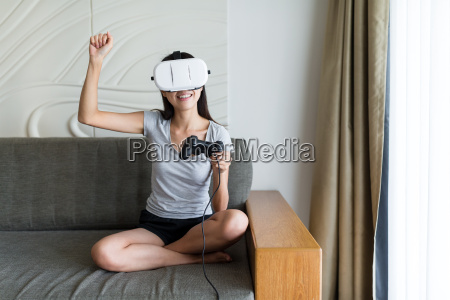 excited, woman, play, game, with, virtual - 20507049